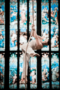 Acrobat in frong of a stained glass window